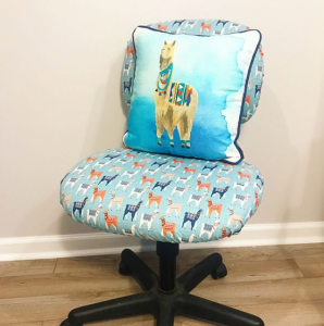 Llama themed office chair with llama pillow